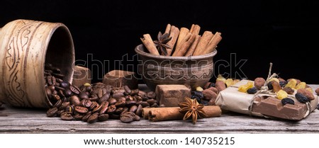 Chocolate bar and spices on wooden table. Selective focus - stock photo