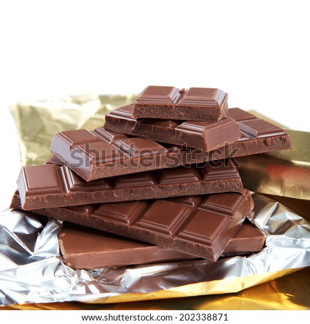 Chocolate bar in foil isolated on white background. - stock photo