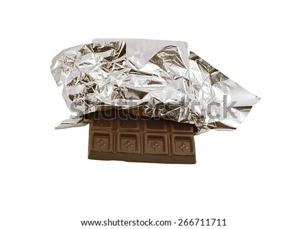 chocolate bar in opened foil wrapping. - stock photo
