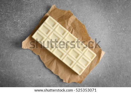Chocolate bar on color background