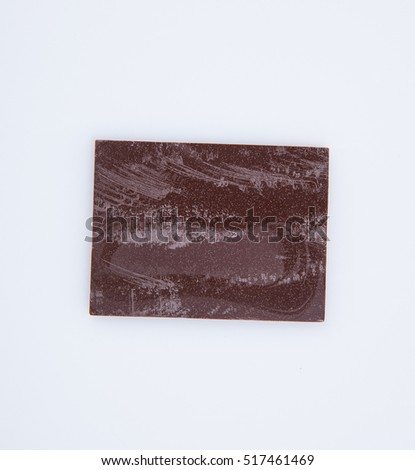 Chocolate bar or pieces on a background