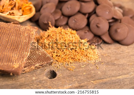 chocolate bar shredded chocolate and bonbons on a wooden table selective focus - stock photo