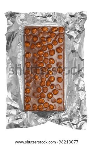 chocolate bar with hazelnuts in aluminum foil, isolated - stock photo
