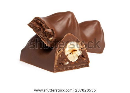 Chocolate bar with nuts on a white background - stock photo