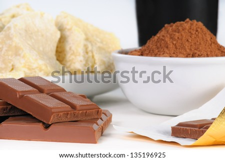 Chocolate Bars and  Ingredients, cocoa powder, cocoa butter, and cream - stock photo