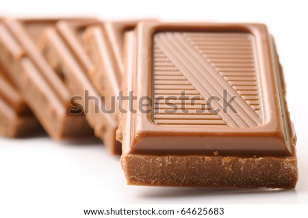 chocolate bars in row isolated on white