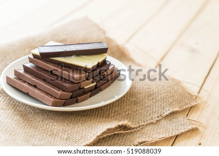 chocolate bars on wood background
