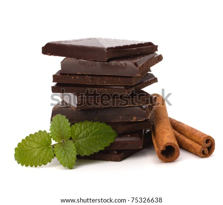 Chocolate bars stack and cinnamon sticks isolated on white background - stock photo