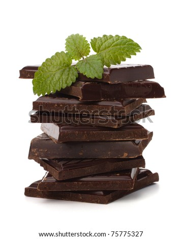 Chocolate bars stack and mint leaf isolated on white background - stock photo