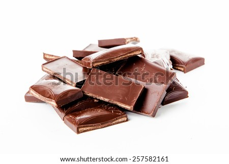 Chocolate bars stack isolated on white background. Chocolate blocks
