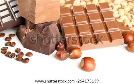 Chocolate bars with hazelnuts and coffee beans close up - stock photo