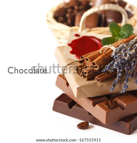 Chocolate bars with spices on a white background. - stock photo