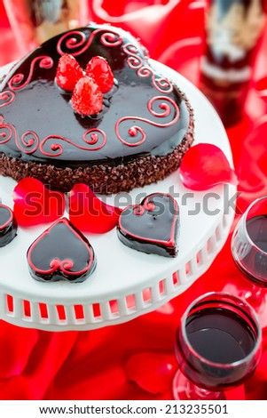 Chocolate beer and wine pairings. Raspberry Flourless Cake with Zinfandel wine for Valentines day. - stock photo