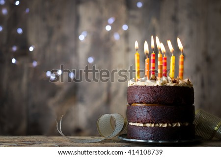 Chocolate birthday cake with candles