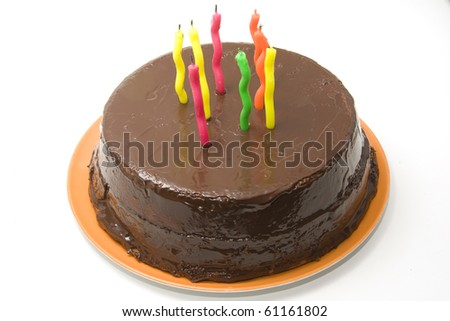 chocolate birthday cake with candles - stock photo