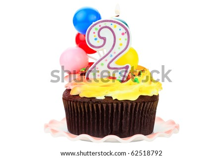Chocolate birthday cake with number  two candle and plastic balloons. Isolated on a white background. - stock photo