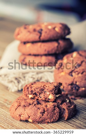 Chocolate biscuit cookies. Chocolate cookies on white linen napkin on wooden table.