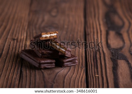 Chocolate biscuits on dark brown wooden background