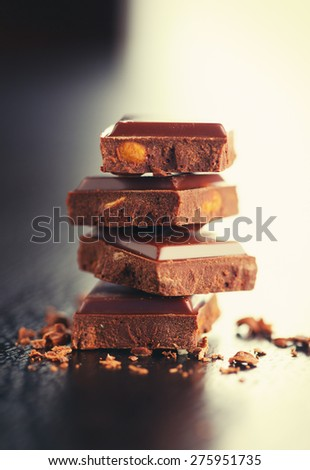 Chocolate blocks on table close-up - stock photo