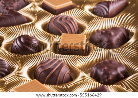 Chocolate box with chocolates of different kinds, horizontal image