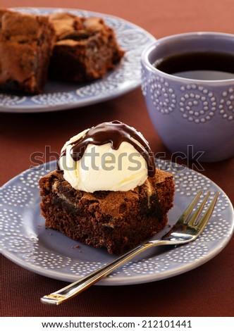 Chocolate brownie cake with strawberries. - stock photo