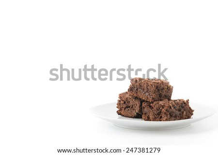 chocolate brownie with chocolate chips on white background - stock photo