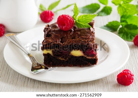 Chocolate brownie with raspberries and mascarpone. - stock photo