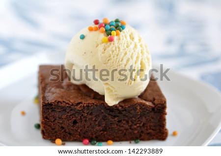 Chocolate Brownie with Vanilla Ice Cream and Sprinkles - stock photo