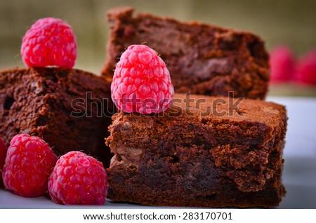 Chocolate brownies and raspberries - stock photo