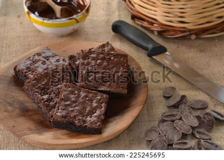 Chocolate brownies dish and ingredients. - stock photo