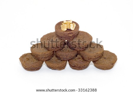 Chocolate brownies in pyramid with walnut on top