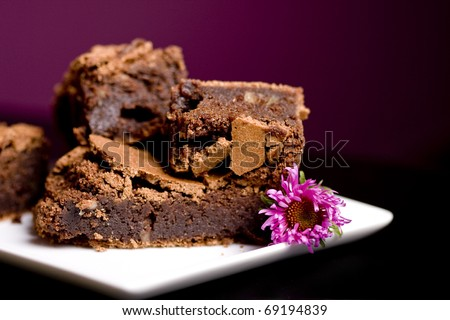 Chocolate Brownies on a White Platter on a restaurant table - stock photo