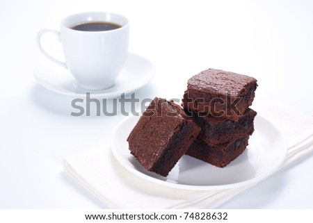 Chocolate brownies on the cake stand and cup of cofee