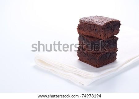 Chocolate brownies on white napkin - stock photo