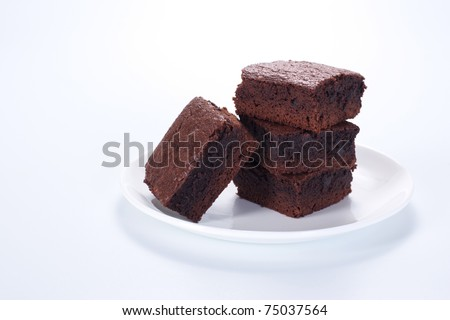 Chocolate brownies on white plate - stock photo