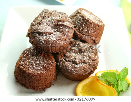 Chocolate brownies stacked up sprinkled with icing sugar. - stock photo