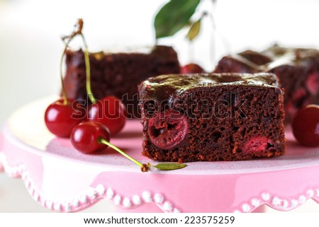 Chocolate brownies with cherries - stock photo