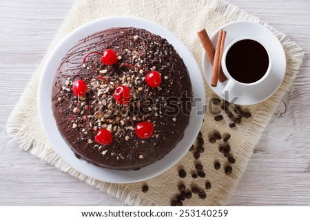 chocolate cake and coffee on the table. horizontal view from above  - stock photo