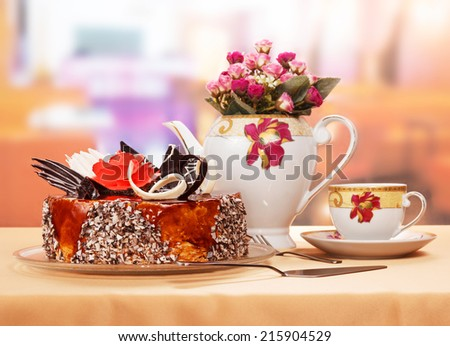 Chocolate cake and cup of tea in cafe - stock photo