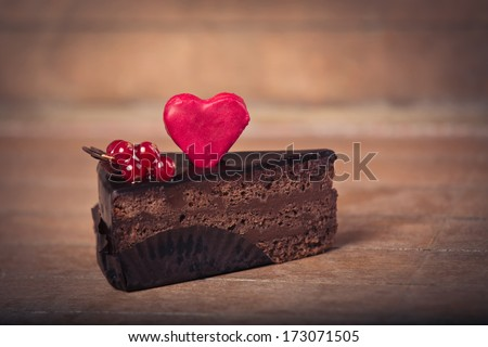 Chocolate cake and heart shaped cookies - stock photo
