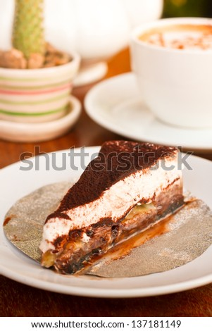 chocolate cake - chocolate cake with banana and a cup of coffee on table