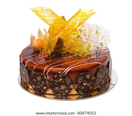 Chocolate cake decorated by caramel isolated on White - stock photo