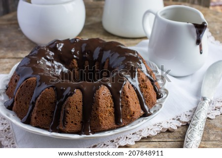 chocolate cake decorated chocolate glaze on a old wooden background - stock photo