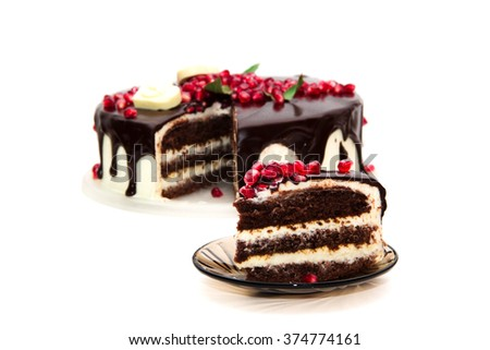 chocolate cake decorated with red garnet and white hearts - stock photo