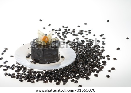 Chocolate cake food on a white plate and spilling coffee beans