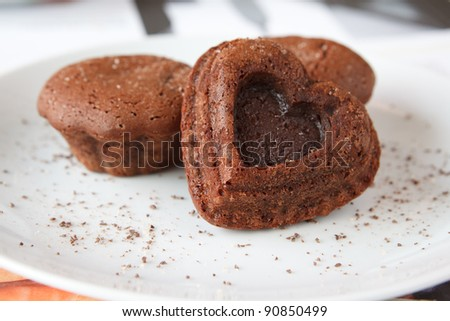 chocolate cake in the shape of a heart - stock photo