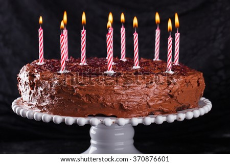 Chocolate cake on a dark background,to birthday,with candles.selective focus - stock photo