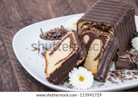 Chocolate Cake on a plate against wooden background