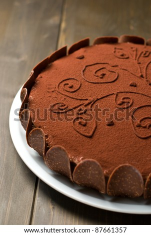 Chocolate cake on a wooden table - stock photo