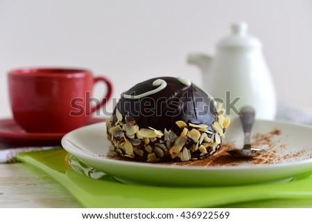 Chocolate cake on plate on table. Homemade chocolate Cake - stock photo